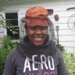 Maya in beekeepers hat and veil
